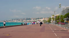 People walk on the Promenade des Anglais in Nice - stock footage