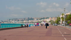 People are walking on the Promenade des Anglais in Nice - stock footage