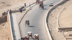 Time Lapse Zoom of Tourist Traffic at the Giza Pyramids Stock Footage