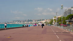 People walk on the Promenade des Anglais in Nice city - stock footage