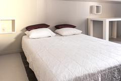 Prepared fresh bed, scene in apartments room Stock Photos