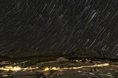 Starry night over the italian mountains - stock photo