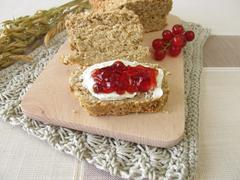 Oat bread with redcurrant jam - stock photo