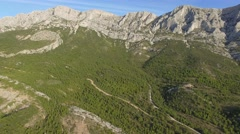 Rocky peaks and slopes of the Sainte-Victoire mountain, South of France – aerial Stock Footage