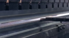 Press machine bends perforated metal profile Stock Footage