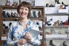 Woman Running Online Shoe Business - stock photo