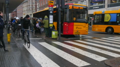 Bicyclists and a bus in rush our traffic Stock Footage