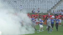 American football players and smoke on Cluj Arena, Cluj-Napoca Stock Footage