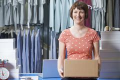 Woman Running Online Clothing Business - stock photo