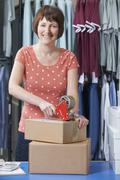 Businesswoman Running Online Clothing Business - stock photo