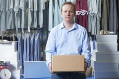 Portrait Of Man Running On Line Clothing Business - stock photo