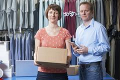 Couple Running Online Clothing Business - stock photo