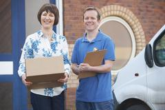 Courier Delivering Package To Client - stock photo