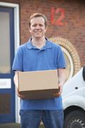 Courier Delivering Package To Office - stock photo