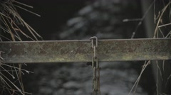 Metal beams over stream close up Stock Footage