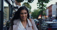 Beautiful Indian woman walking though city Stock Footage
