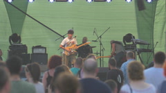 Playing the guitar at River Fest, Cluj-Napoca Stock Footage