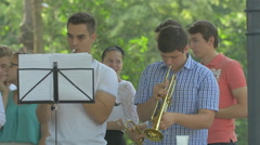Holding the trumpets in Central Park, Cluj-Napoca Stock Footage