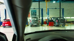 Timelapse Horizontal slide shot from the inside out in a service station garage Stock Footage