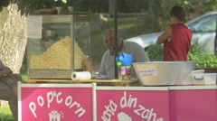 Stock Video Footage of Selling popcorn and cotton candy in Central Park, Cluj-Napoca
