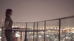 Happy couple enjoying amazing view from rooftop terrace at night Stock Footage