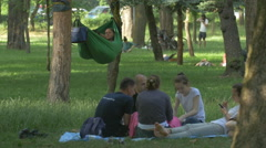 Young adults relaxing in Central Park, Cluj-Napoca Stock Footage