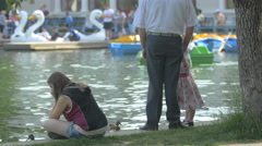 Relaxing on the waterfront in Central Park, Cluj-Napoca Stock Footage