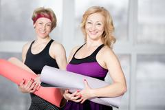 Portrait of two mature athletic women - stock photo