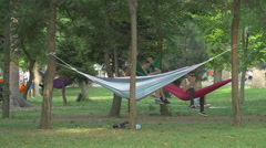 Relaxing in hammocks in the park, Cluj-Napoca Stock Footage