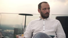 Sad, unhappy man drinking cocktail in bar Stock Footage