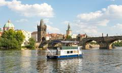 Stock Photo of Ferry Boaty on Moldava river - Prague- Czech Republic
