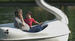 Pedaling a swan pedal boat in Cluj-Napoca Stock Footage