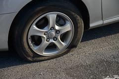 POCHEON, KOREA - SEPTEMBER 06, 2014: flat tire - stock photo