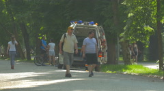 Taking a stretcher out of an ambulance in Central Park, Cluj-Napoca Stock Footage