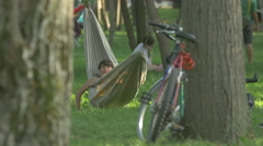 Swinging in a hammock in Central Park, Cluj-Napoca Stock Footage
