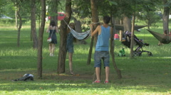 Tying a hammock in Central Park, Cluj-Napoca Stock Footage