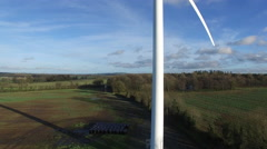 4K aerial shoot of wind mills in Ireland fields Stock Footage