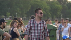 Man with sunglasses relaxing on the riverside in Cluj-Napoca Stock Footage