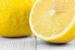 Fresh Yellow Lemons On Wood - stock photo