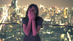Stock Video Footage of Sad woman crying on terrace in city at night