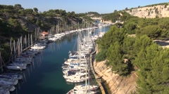 Travelling along the Calanque de Port-Miou marina harbour, Cassis, Cote d'Azur, Stock Footage