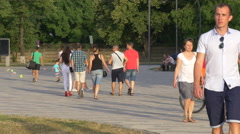 Stock Video Footage of Riding bikes and walking near Cluj Arena, Cluj-Napoca