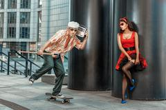 Old grandfather rushes on a skateboard. - stock photo