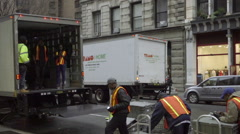 Movers with orange construction vests crating cargo on Broadway in NYC, 1080 HD Stock Footage
