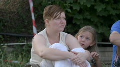 Mother and daughter sitting at River Fest, Cluj-Napoca Stock Footage