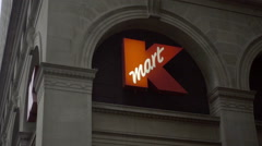 K Mart sign on building tilting down to cars and taxi cab driving Broadway NY HD Stock Footage