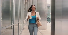 Beautiful mixed race business woman walking through city Stock Footage