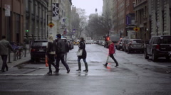 New Yorkers walking across street at NoHo crosswalk on Broadway NYU building NYC Stock Footage