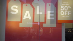 Sale 50 percent off sign on store window display, reflection of street, NYC 1080 Stock Footage