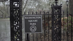 South entrance sign Washington Square Park on rainy day cold fall winter NYC Stock Footage